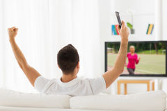 Man watching sport channel on tv and at home Royalty Free Stock Photos