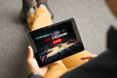 Man watching sports on live streaming online service. While sitting on the floor Royalty Free Stock Photo