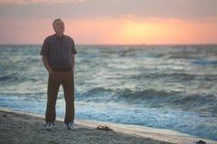 Man watching the sunrise on beach Stock Image