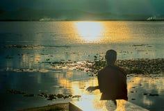 Man watching sunset. The man watching sunset in the lake Royalty Free Stock Photo