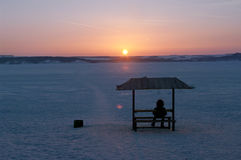 Man watching sunset Stock Photography