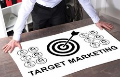 Target marketing concept on a desk. Man watching a target marketing concept placed on a desk Royalty Free Stock Images