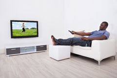 Man watching television stock image