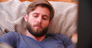 Man Watching Television At Home Then Answering Mobile Phone stock footage