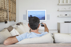 Man Watching Television In Living Room Stock Photography