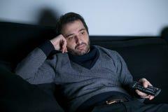 Man watching television at night Royalty Free Stock Photos