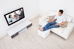 Man watching television Stock Photography