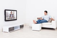 Man watching television Stock Image