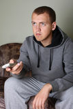 Man watching tv. Portrait of young man watching tv Stock Images