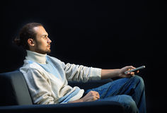 Man watching TV Stock Images