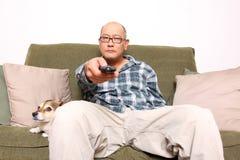 Man watching TV Stock Photos