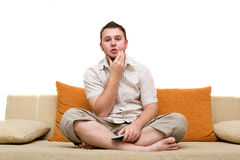 Man watching tv. Casual man watching tv on sofa Royalty Free Stock Photos