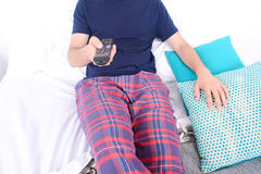 Man watching tv on bed. Portrait of young man watching tv and relaxed on bed. Indoors Royalty Free Stock Image