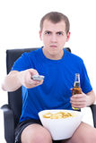 Man watching tv and changing channels Stock Photo