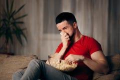 Man Watching TV Eating Pop Corn royalty free stock images