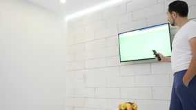 Man Watching Tv Green Screen In The Room.  stock footage