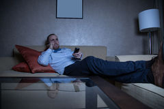 Man watching TV Stock Image