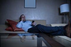 Man watching TV Stock Image