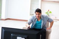 The man watching tv at home. Man watching tv at home Royalty Free Stock Photos