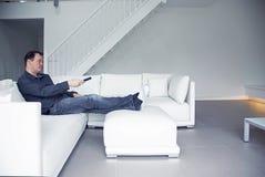 Man is watching TV Stock Photo