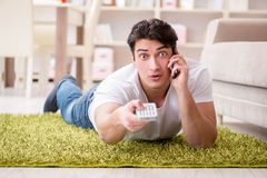 The man watching tv at home on floor. Man watching tv at home on floor Royalty Free Stock Image
