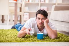 The man watching tv at home on floor. Man watching tv at home on floor Royalty Free Stock Photos