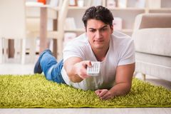 The man watching tv at home on floor. Man watching tv at home on floor Stock Photos