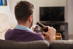 Man watching tv at home Royalty Free Stock Photos