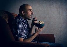 Man watching tv at night. Royalty Free Stock Photos