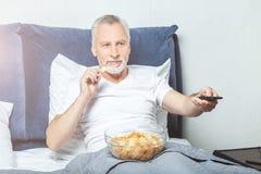 Man watching tv royalty free stock photo