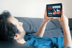 Man watching movies streaming with digital tablet Stock Images