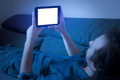 Man watching tv series on streaming with digital tablet. Man watching tv series on streaming with a digital tablet stock photo