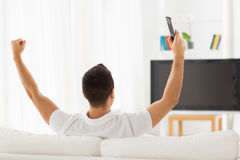Man watching tv and supporting team at home Royalty Free Stock Photos