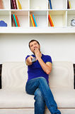 Man watching tv and yawning Royalty Free Stock Photo