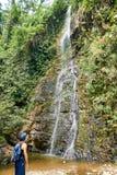 Man watching waterfall at holiday in Vang Vieng , Loas stock photos