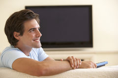 Man Watching Widescreen TV At Home Royalty Free Stock Photos