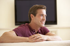 Man Watching Widescreen TV At Home Royalty Free Stock Photo
