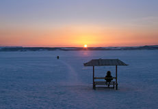Man watching winter sunset Stock Photography