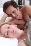 Man watching woman sleeping Royalty Free Stock Photography