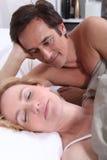 Man watching woman sleeping. Man watching his wife sleep Royalty Free Stock Photography