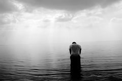 Man in water in black and white Royalty Free Stock Image