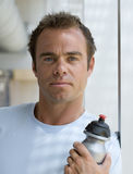 Man with water bottle, portrait, close-up Stock Image