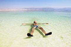A man on the water of the dead sea in Israel Stock Image