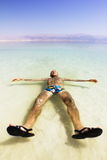 A man on the water of the dead sea in Israel Royalty Free Stock Photo