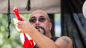 Man with a Water Gun Stock Photo