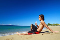 Man with water in hand on beach Royalty Free Stock Image