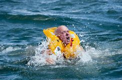 Man in water with life jacket on Stock Photo