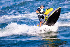 Man on the water motocycle Stock Photography