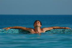 Man in water pool. The man in water pool Stock Photography