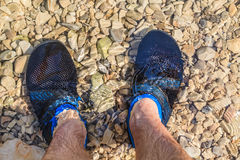 Man in water shoes Royalty Free Stock Photos